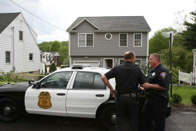 SHELTON, CT - MAY 4:   Police stand outside a former home, which was forclosed on, owned by Faisal Shahzad is seen May 4, 2010 in Shelton, Connecticut. Faisal Shahzad, 30, a suspect in this past weekend's failed car bomb plot in Times Square was taken into custody late Monday by FBI agents and New York Police Department detectives while trying to leave the country at John F. Kennedy Airport.  (Photo by Daniel Barry/Getty Images) Photo: Daniel Barry, Getty Images / 2010 Getty Images