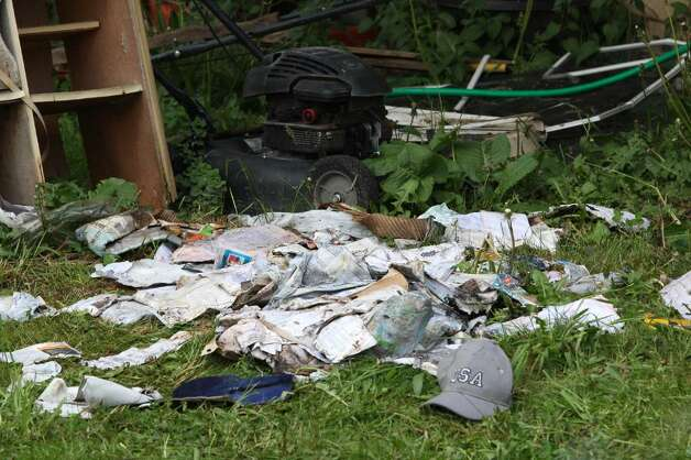 SHELTON, CT - MAY 4:   A pile of mail and personnel belongings in the rear of a former home, which was forclosed on, owned by Faisal Shahzad May 4, 2010 in Shelton, Connecticut. Shahzad, a suspect in this past weekends failed bomb plot in New York City's Times Square was taken into custody late Monday by FBI agents and New York Police Department detectives while trying to leave the country.  (Photo by Daniel Barry/Getty Images)) Photo: Daniel Barry, Getty Images / 2010 Getty Images