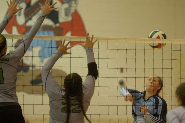 Greenwood's Kyndall Dove (13) hits against Monahans on Tuesday, Sept. 27, 2016 at Greenwood High School.  James Durbin/Reporter-Telegram