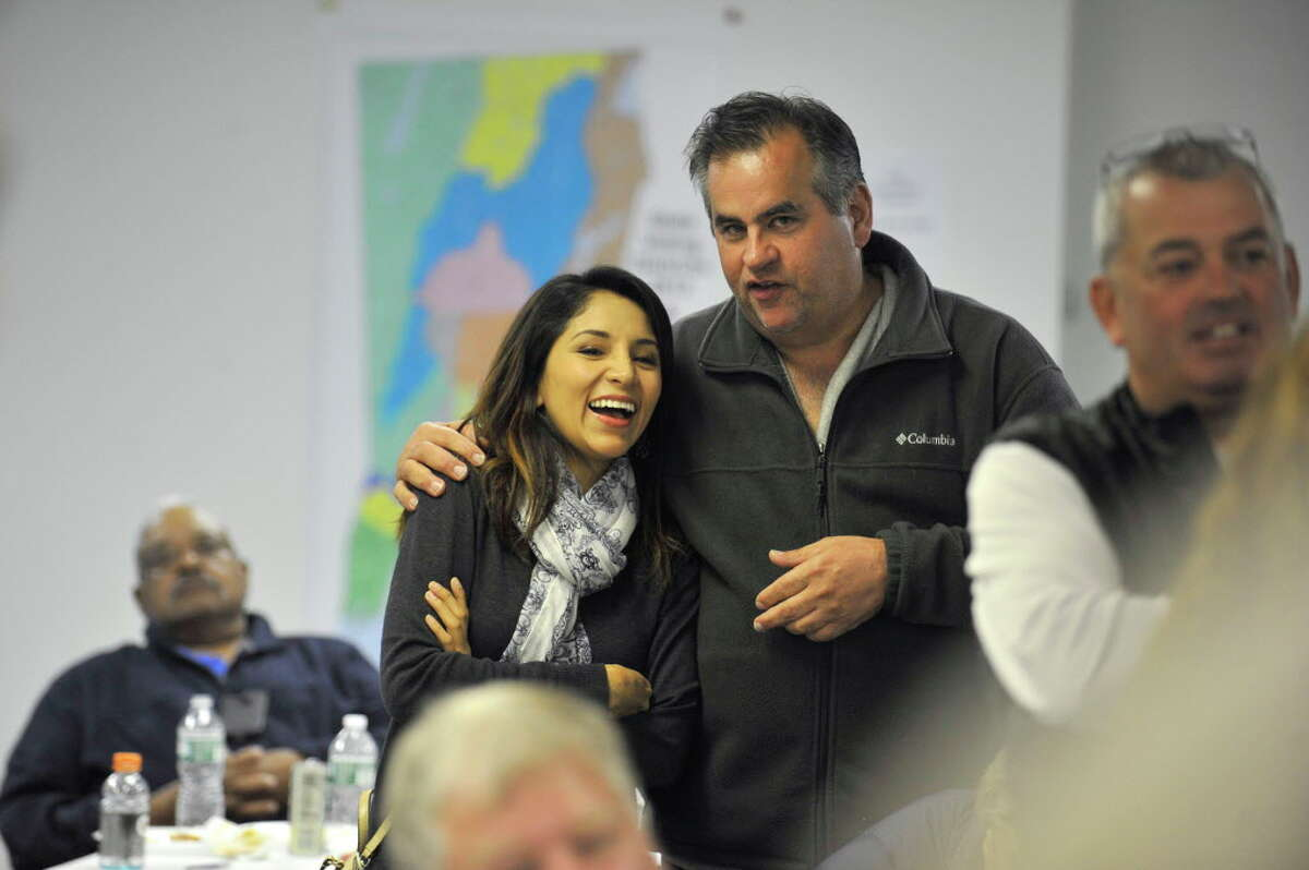 FILE - Board of Representative candidate Michael Briscoe, right, consoles Angelica Gorrio after losing at the Democratic Headquarters on Tuesday night, Nov. 3, 2015.