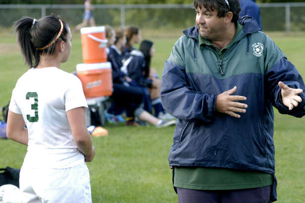 Greg LaCava, offering advice to Jen Millar in a game against Weston in 2013, who took the New Milford girls' soccer team to a state championship in 2014, is in his first season coaching the boys' team.