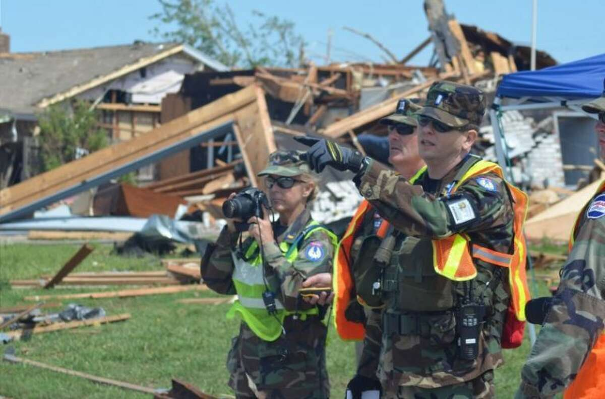 First Lt. Becky Postma-Kegleg of the Texas Wing prepares to photograph a damaged residence with assistance from Capt. Danny Arnold of the Oklahoma Wing and 2nd Lt. Johnathan Foster of the Texas Wing. CAP ground teams are taking GPS-tagged photos of damaged structures in the hardest-hit areas in Moore, Okla.