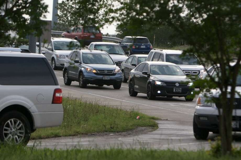 Traffic is seen on the Woodlands Parkway-Robinson Road cloverleaf near rush hour.