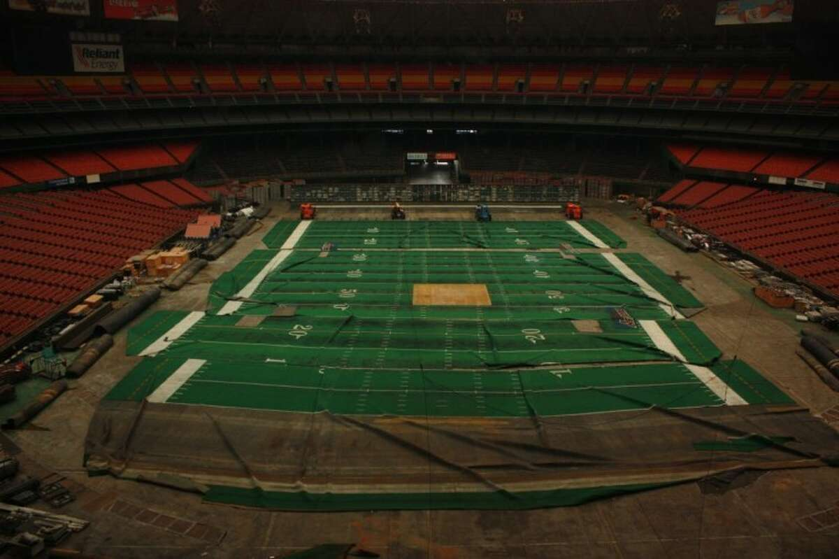 An endzone-to-endzone view of the disheveled Astroturf.