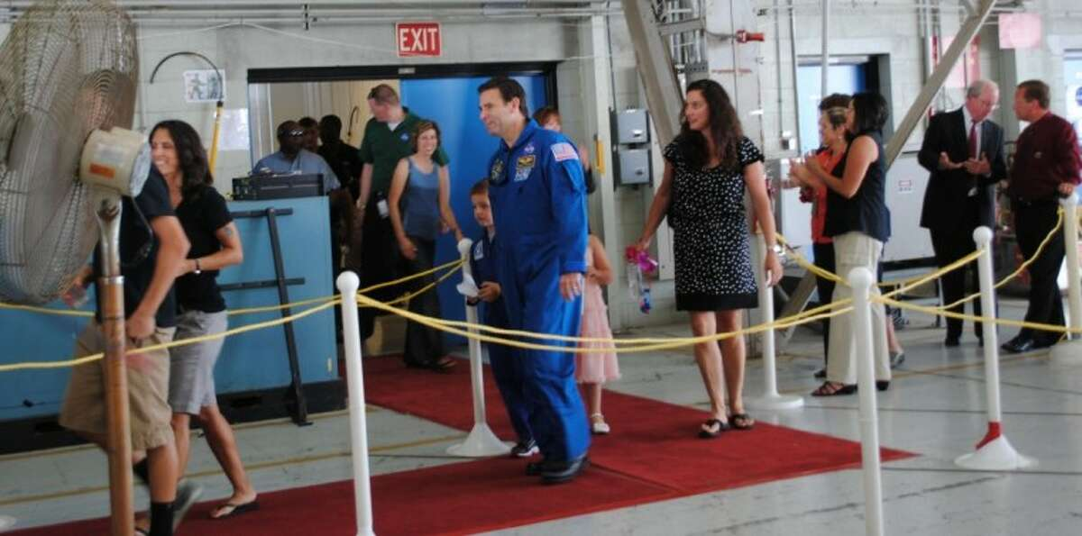 The crew of the Endeavour mission and their families arrive at the Ellington hangar for the welcome home ceremonies.