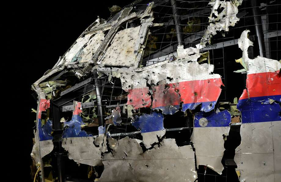 The wrecked cockipt of the Malaysia Airlines flight  MH17 is exhibited during a presentation of the final report on the cause of the its crash at the Gilze Rijen airbase October 13, 2015. Air crash investigators have concluded that Malaysia Airlines flight MH17 was shot down by a missile fired from rebel-held eastern Ukraine, sources close to the inquiry said today, triggering a swift Russian denial. The findings are likely to exacerbate the tensions between Russia and the West, as ties have strained over the Ukraine conflict and Moscow's entry into the Syrian war. / AFP / EMMANUEL DUNAND        (Photo credit should read EMMANUEL DUNAND/AFP/Getty Images) Photo: EMMANUEL DUNAND/AFP/Getty Images