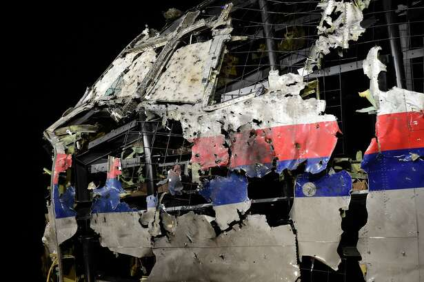 The wrecked cockipt of the Malaysia Airlines flight  MH17 is exhibited during a presentation of the final report on the cause of the its crash at the Gilze Rijen airbase October 13, 2015. Air crash investigators have concluded that Malaysia Airlines flight MH17 was shot down by a missile fired from rebel-held eastern Ukraine, sources close to the inquiry said today, triggering a swift Russian denial. The findings are likely to exacerbate the tensions between Russia and the West, as ties have strained over the Ukraine conflict and Moscow's entry into the Syrian war. / AFP / EMMANUEL DUNAND        (Photo credit should read EMMANUEL DUNAND/AFP/Getty Images)