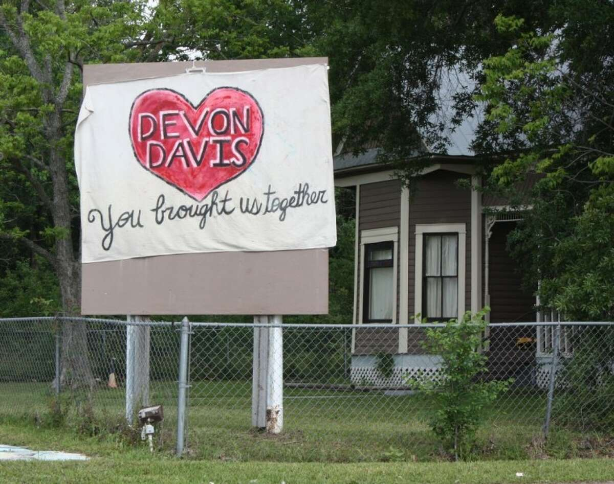 A homeowner on Houston Street in Cleveland has posted a banner in front of their home in honor of 2-year-old Devon Davis, whose body was found floating in a lake in Sam Houston Lake Estates on March 31, days after he disappeared from his family's home.