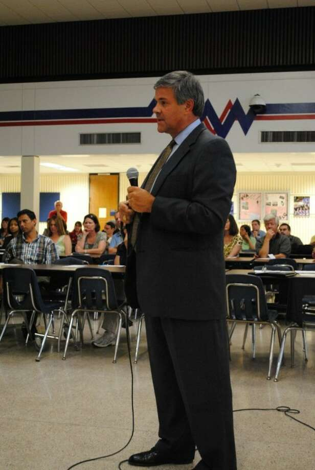 Clear Creek ISD Superintendent Dr. Greg Smith listens as a parents asks a budget question at the CCISD Forum Monday night in the Clear Lake High Commons. Photo: Mary Alys Cherry