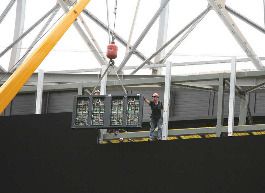 Workers put in place one of 297 videoboard panels, each weighing 500 pounds on one end of the new Houston Texans Digital HD Videoboard at Reliant Stadium. The stadium will have two videoboards on each end of the field. The 277-foot wide High Definition display will be the largest in the NFL and operational when the Texans start their preseason schedule in August.