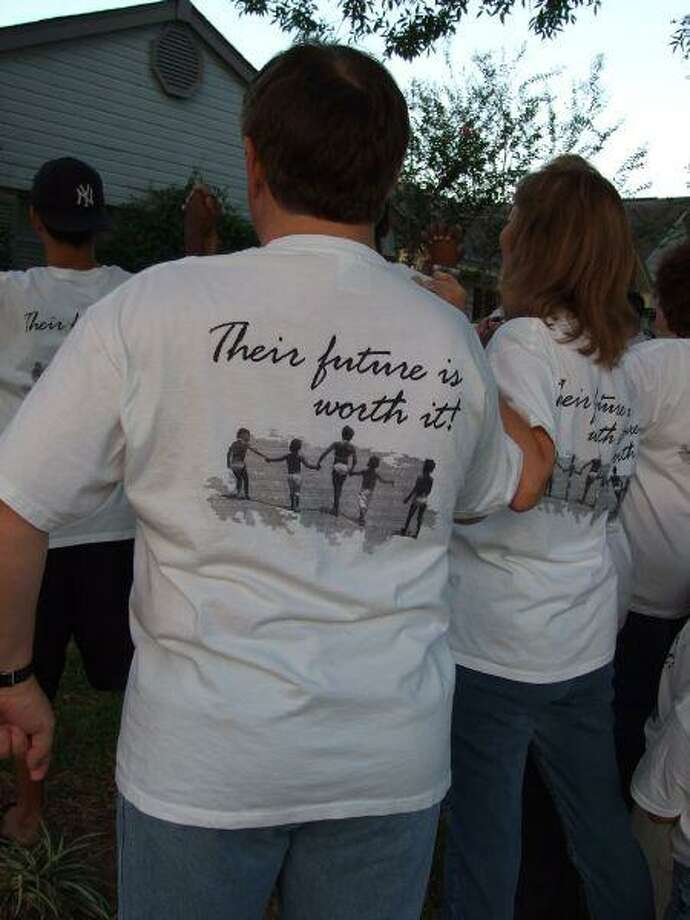 """The T-shirts made by residents of Kleinbrook read """"Back Rhonda because,"""" and the backs read """"their future is worth it."""""""