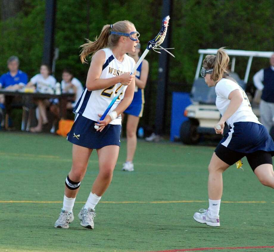 Weston senior captain Brittany Swanson scored three goals, including the game-winner on Friday in a 10-9 home win over Brookfield. The Lady Trojans raised their record to 6-4 with the victory. Photo: Contributed Photo / Will Chepolis