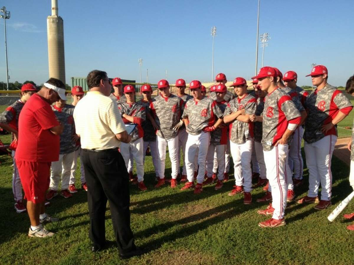 """City of Bellaire Mayor Phil Nauert (center) and City Councilman Corbett D. Parker honored Cardinals coach Rocky Manuel (left) prior to the team's 6-4 victory against Lamar on Thursday at Knoblauch Field. Manuel was proclaimed an Outstanding Citizen """"in recognition of his outstanding service and dedication to the community."""" Manuel recorded his Houston ISD record-setting 800th victory last month and has led Bellaire to a 9-0 start to District 20-5A play this season."""