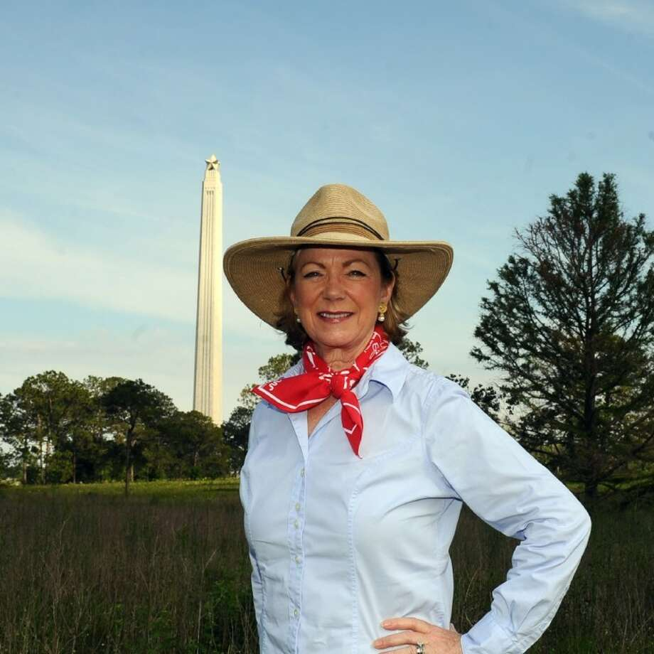 Sarita Hixon, with the Texas Historical Commission, stands on the San Jacinto Battleground with the San Jacinto Monument in the background. The area will be the spot of the San Jacinto Day Festival and Battle Re-enactment on April 21.