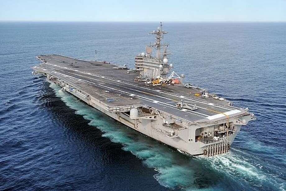 The aircraft carrier USS George H.W. Bush (CVN 77) conducts training operations in the Atlantic Ocean. / Navy Media Content Service (NMCS