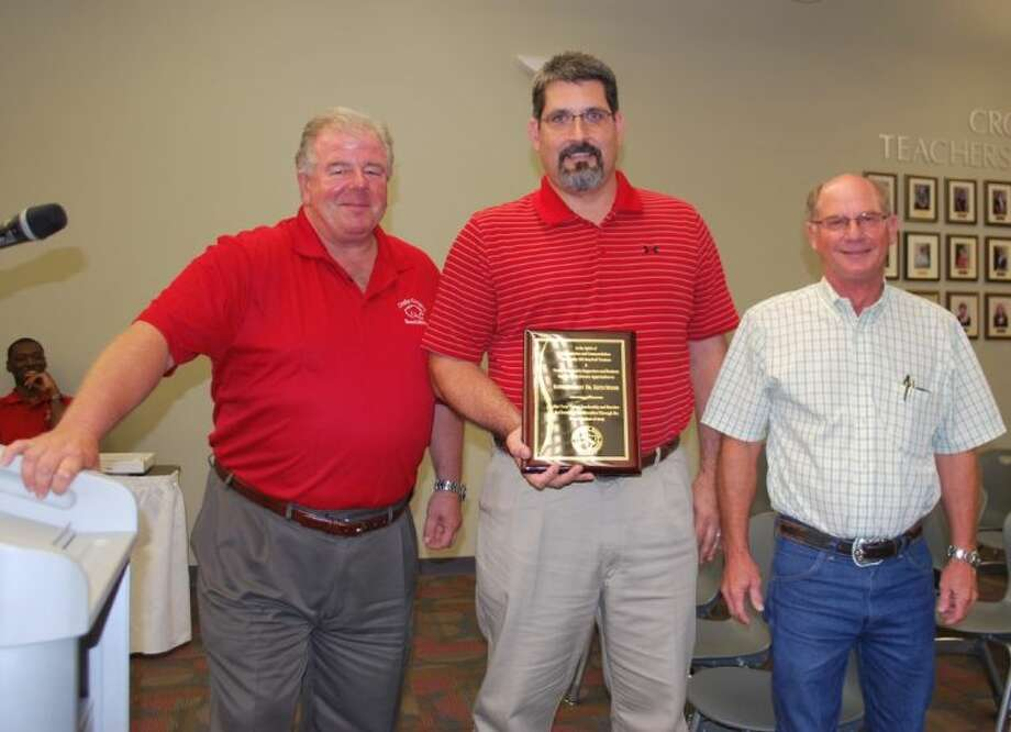 The Crosby ISD Board of Trustees recently recognized Superintendent Dr. Keith Moore with a plaque for his work with the recent bond election. Shown from left to right are board member Dan Kasprzak, Dr. Keith Moore and Board President John Lindsay . Dan Kasprzak is pictured presenting Dr. Moore with the award. Photo: Anthony J. Turner