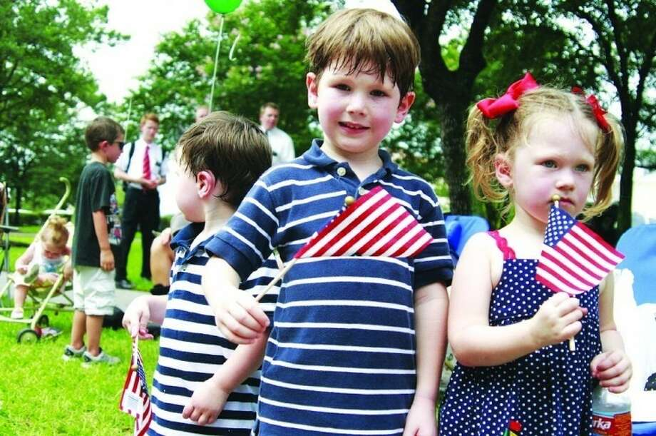 Wilson, Cate and Hudson Leslie of Kingwood showed their patriotic spirit during last year's patriotic events.