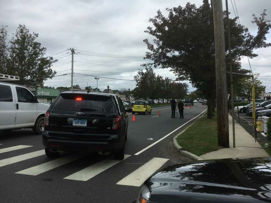 Police investigate the scene of an accident at Black Rock Turnpike Wednesday morning. Photo: Genevieve Reilly, Hearst Connecticut Media / Fairfield Citizen