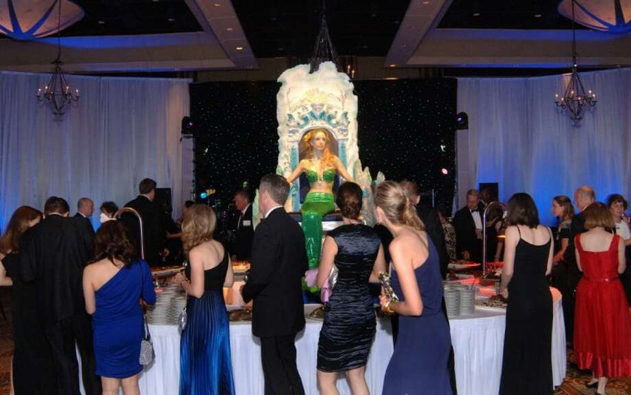 "Dinner is topped off with a dessert extravaganza under the watchful eye of Neptune's daughter at ""Catch the Wave"" Gala and Auction. (Photo submitted by University of Houston Law Center)"