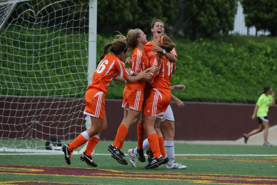 Seven Lakes celebrates a goal against Clements in the 2012 Region III playoff game Friday, 4/13. Photo: KIRK SIDES