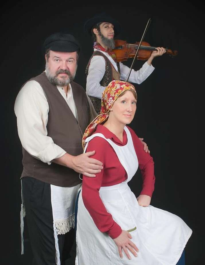 "Jeff Baldwin stars as Tevye, Nora Hahn as Golde, and Eric Olmos Tristan as Fiddler in the Houston Family Arts Center production of ""Fiddler on the Roof."" Photo: Audree Garcia Photography"