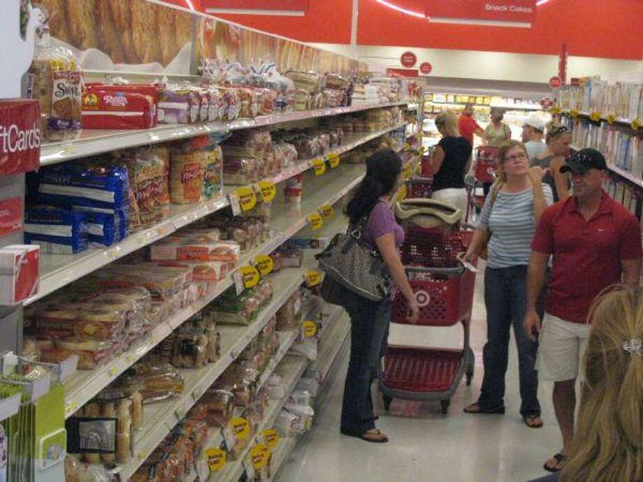FILE - Customers stock up on supplies at a SuperTarget in Atascocita, Texas on Sept. 11, 2008. The store is now the center of a racial discrimination suit alleging managers falsely accused a customer of theft.