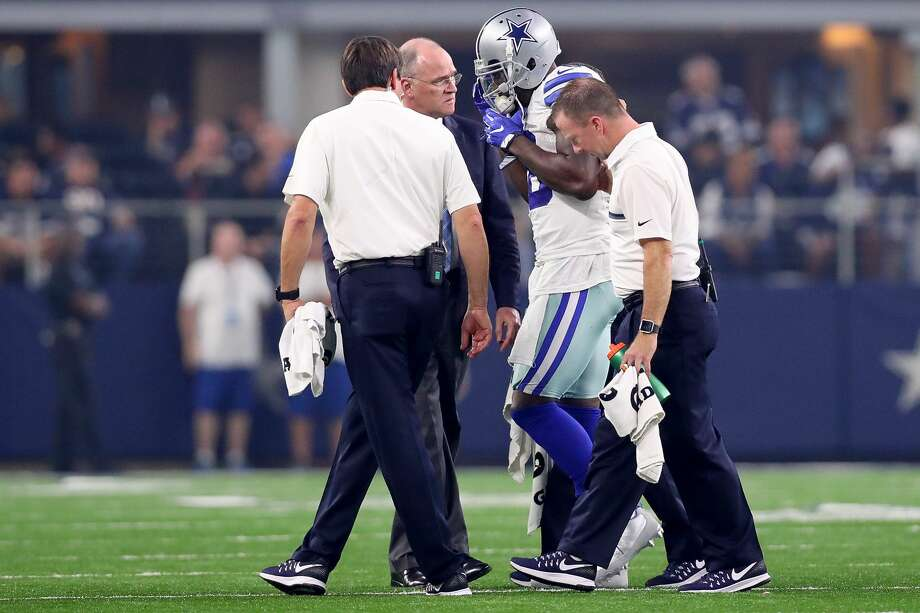 ARLINGTON, TX - SEPTEMBER 25:  Dez Bryant #88 of the Dallas Cowboys is assisted by team personel after taking a hit from the Chicago Bears at AT&T Stadium on September 25, 2016 in Arlington, Texas.  (Photo by Tom Pennington/Getty Images) Photo: Tom Pennington/Getty Images