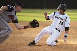The Woodlands Strykers' Brian Smith slides safely into third base during the first game of a two-game series against the Acadiana Cane Cutters on Tuesday night. To view or purchase this photo and others like it, visit HCNpics.com.