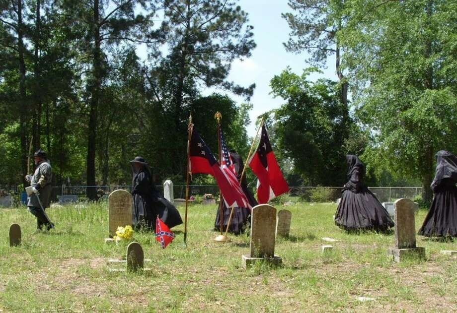 A Civil War re-enactment ceremony was held to dedicate a Confederate memorial marker at the McGinnis Cemetery in Tarkington Prairie. The marker was dedicated in memory of Jesse H. Tarkington, son of Burton and Sarah Tarkington, the original settlers of the area in the early 1830s.