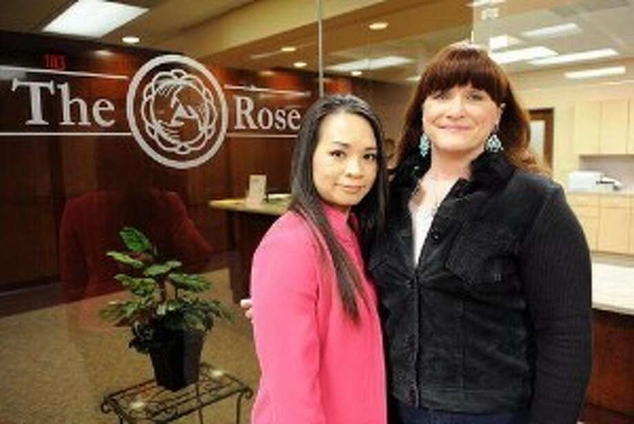 Tran in 2010 with Rose patient Christine Steele.
