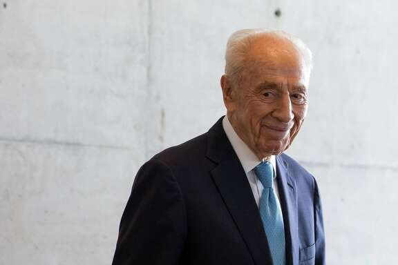 A picture taken on May 22, 2016 shows Israeli President Shimon Peres welcoming the French prime minister before at the Peres Centre for Peace in the Israeli coastal city of Tel Aviv. Israeli ex-president and Nobel Peace Prize winner Shimon Peres died on September 28, 2016 some two weeks after suffering a major stroke, triggering an outpouring of grief for the beloved elder statesman.   / AFP PHOTO / JACK GUEZJACK GUEZ/AFP/Getty Images