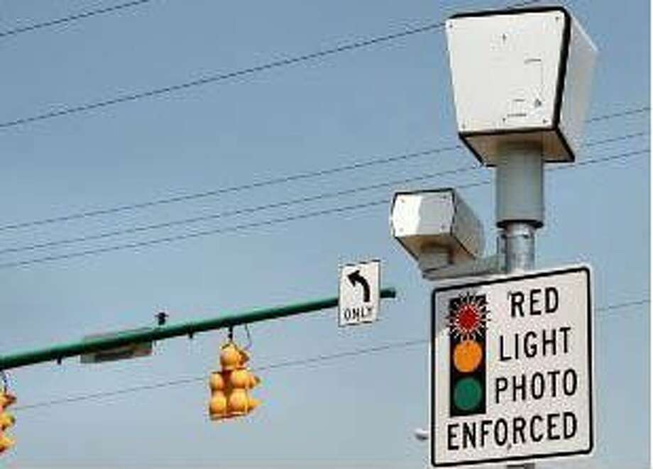 If Houston red light cameras snap a violation, you'll now be ticketed