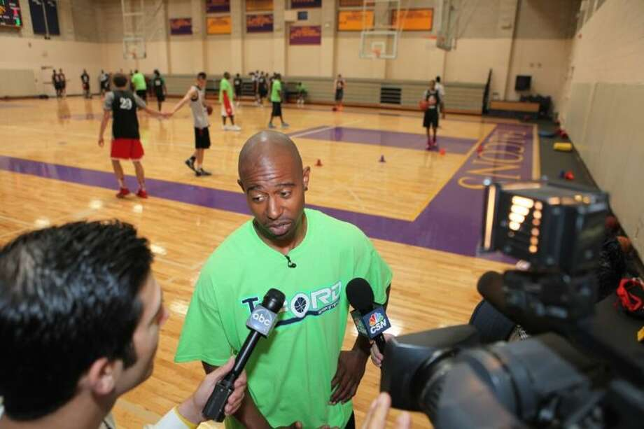 T. J. Ford answers questions for the media at the T. J. Ford Texas Top 60 Elite Basketball Camp, June 20 at Kinkaid High School in Houston. Visit www.hcpics.com for more photos. Photo: Alan Warren