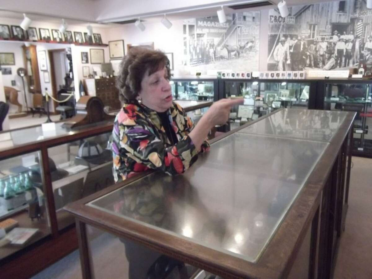 Jerri Christian, office manager at the Humble Museum, shares her knowledge about one of the displays in the museum.