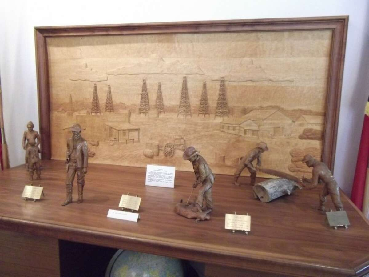 This deep relief diorama of the oil fields and wooden figurines were hand carved by former Humble resident Paula Devereaux. Each figurine took six weeks to make and is carved out of a single piece of wood.