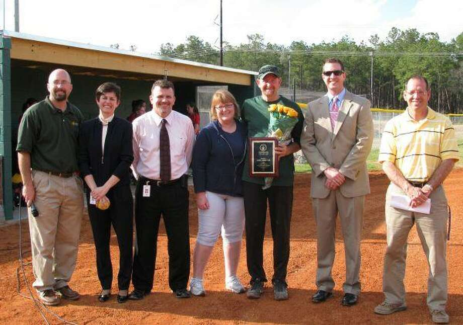 The Woodlands Christian Academy recently dedicated the latest addition to its athletic facilities, a new softball complex. The Lady Warriors played their inaugural game against the Lady Lions of Pope John XXIII and have four additional home games scheduled this season. Pictured from left are Athletic Director Randy Hollas, Head of School Julie Ambler, Principal Steve Zeal, Booster Club President Kerry Cummings, Head Softball Coach John Ledbetter, Liberty Mutual Insurance's Jeremy Hohn and Director of Facilities David Brignac.