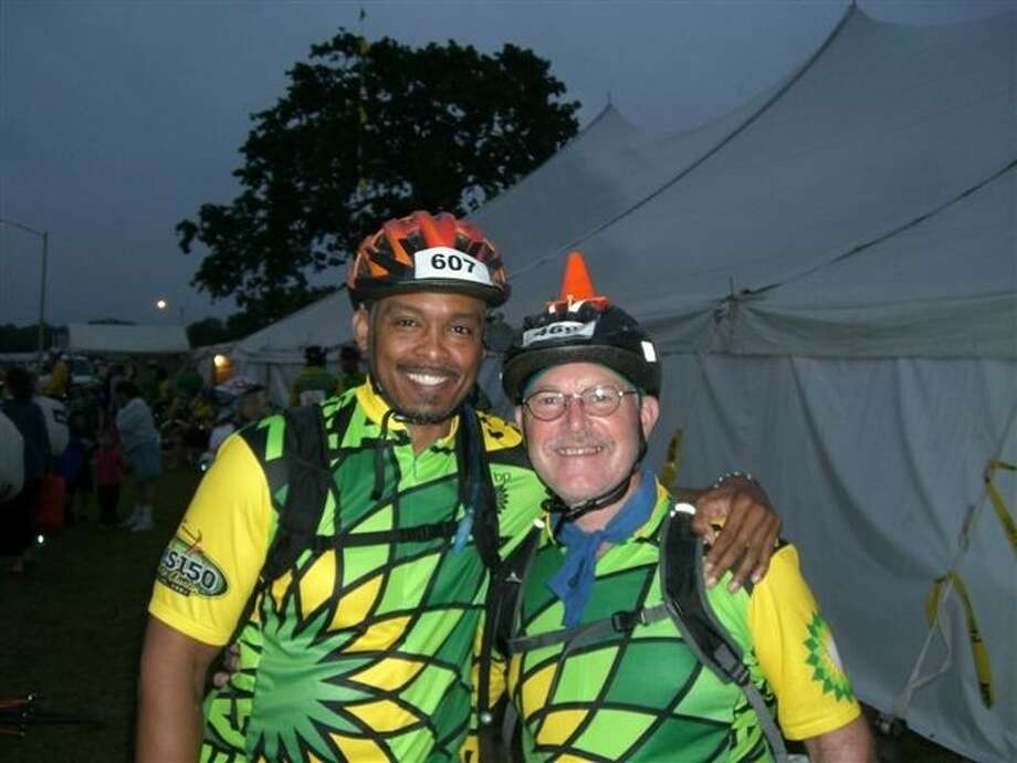 Brian Martin, Spring resident and BP employee, stands with his co-worker, Randy, who has multiple sclerosis, at last year's MS 150.