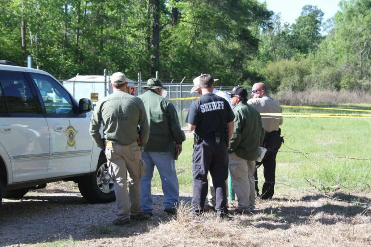 Liberty County sheriff's deputies and investigators on Friday, April 12, prepare to search a property on CR 332 where law enforcement is looking for more human remains after a skull and portions of vertebrae were found Thursday evening by two citizens riding four-wheelers along a pipeline easement.