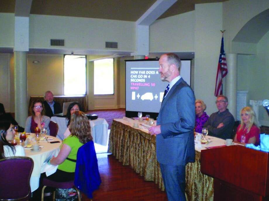 """Personal Injury Attorney Will Adams gives a presentation called """"The Road Less Watched: The Dangers of Texting and Driving Public Awareness Initiative 2013"""" during the Katy Chamber of Commerce's April Luncheon. Photo: Zach Haverkamp"""
