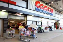 FILE -- Costco shoppers in New York, April 3, 2010. Hearing aids become more expensive over time, while cellphones, computers and televisions have gotten cheaper, but online retailers and even Costco offer lower prices than private audiologists. (Suzanne DeChillo/The New York Times.)