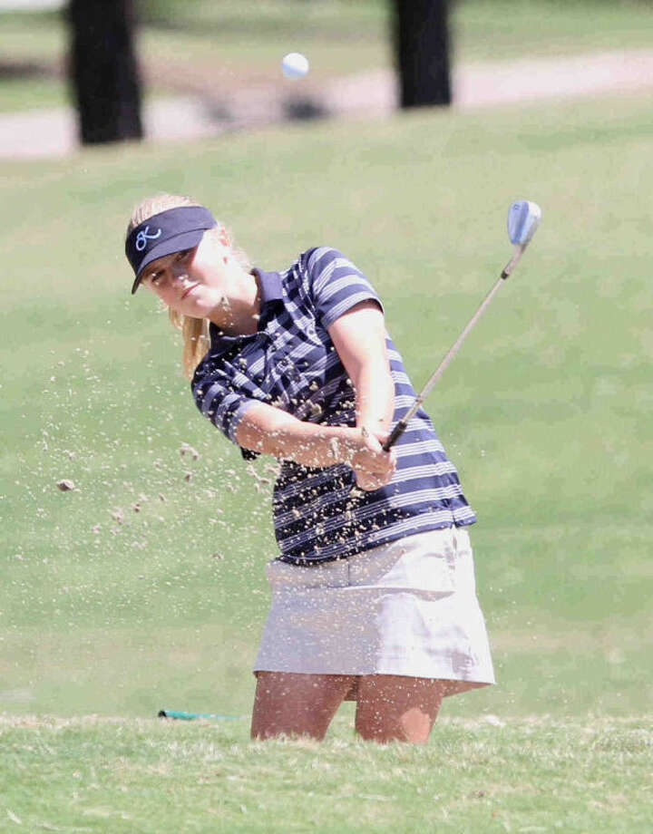 Kingwood's Jacqueline Russ chips a shot in the District 13-5A girls golf tournament at Oakhurst Golf Club on Thursday in Porter. Heavy rains in the morning delayed the start of the tournament until 11:30 a.m. and forced official to modify some course rules. Photo: Staff Photo By Jason Fochtman