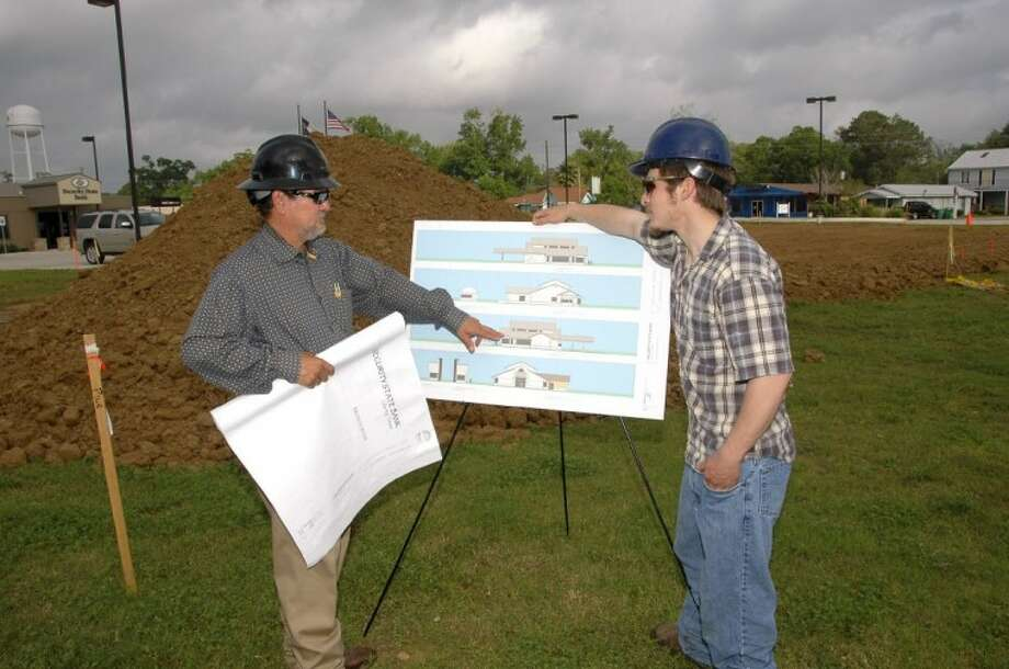 Larry Kness (left), owner of Nest Construction Service and a San Jacinto College graduate, reviews construction site plans with his son Justin, who serves as an assistant construction superintendent for Nest. Photo credit: Rob Vanya, San Jacinto College marketing department.