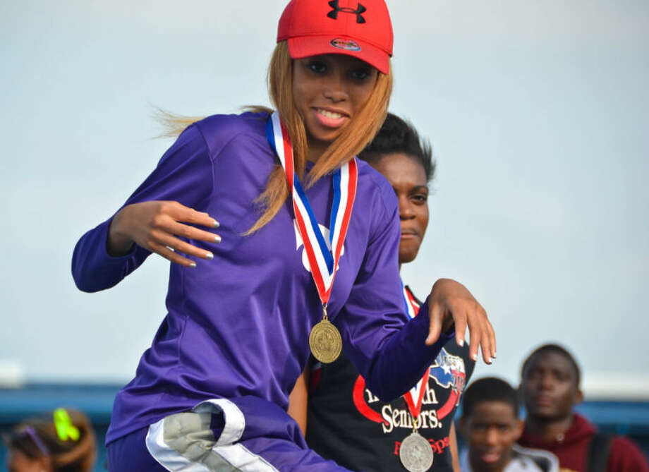 Humble's Marceedez Marchant steps on the medal stand after accepting the gold in the long jump at the District 19-4A Track and Field Championships held April 8, 2013, at Eagle Stadium in Mont Belvieu. Photo: Photo By Stephen Whitfield