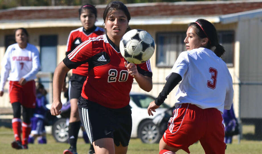 Leticia Ball (20) chases after a loose ball as Sandra Castillo defends during a high school soccer match between Porter and Splendora at the Prepare for Glory Tournament in New Caney on Jan. 18, 2013. Photo: Photo By Stephen Whitfield