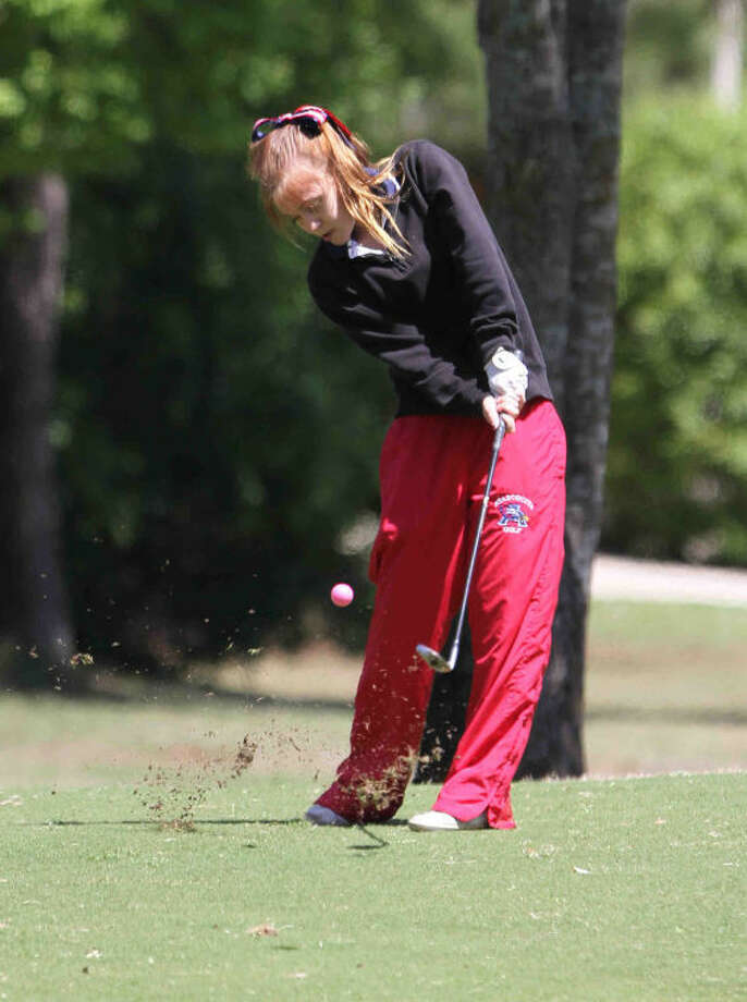 Atascocita's Maria Nnatiuk competes in the District 13-5A girls golf tournament at Oakhurst Golf Club on Thursday in Porter. Heavy rains in the morning delayed the start of the tournament until 11:30 a.m. and forced official to modify some course rules. Photo: Staff Photo By Jason Fochtman