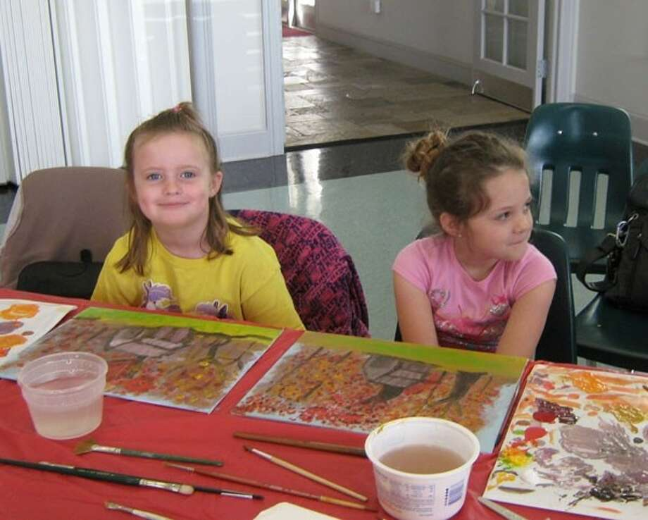 Madison Ehrlich and Maggie Fuller enjoy working on paintings at a Paint-A-Long workshop hosted by members of the Liberty County Art League. Photo: Submitted Photo