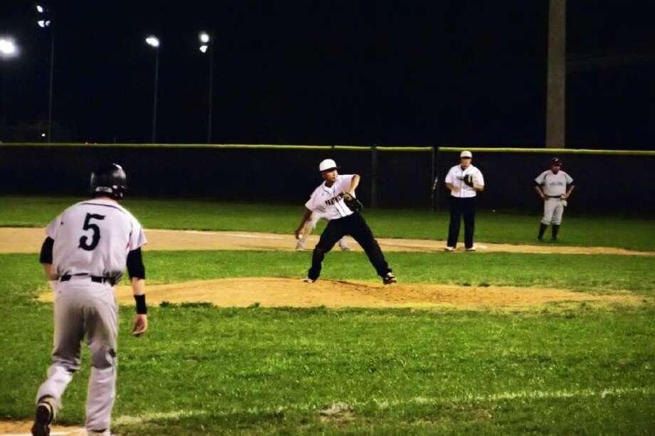 Juan Saavadra pitching in Tuesday night's, April 9, game against Coldspring-Oakhurst. Photo: CASEY STINNETT