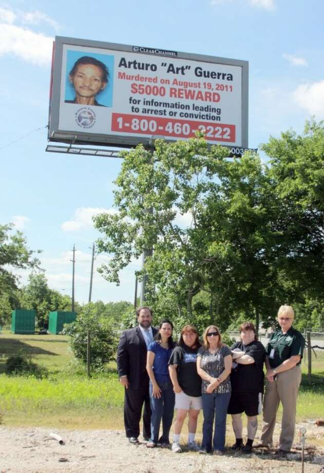 Pearland Police detectives are looking for clues in the unsolved murder of Artura Guerra that occured August 19, 2011. To help track down leads, Clear Channel Outdoor donated a billboard. Family members, law enforcement officials Lee Vela from Clear Channel Outdoor gathered to watch the installation of the billboard Thursday (April 19). From left: Clear Channel Outdoor VP Public Affairs Lee Vela, family members Antonia Florez (sister), Melinda Gonzales (niece), Frances Gonalez (sister), Esmo Gonzalez (niece), Lt. Wilson from Brazoria County Crimestoppers. To report a tip call 1-800-460-2222. Callers may remain anonymous. Photo: KRISTI NIX