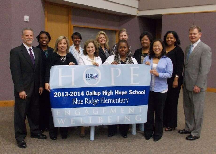 FBISD High Hope School principals shown during a banner presentation are (front row, from left to right): David Yaffie, Baines Middle School; Julie Diaz, Fort Settlement Middle School; Maria Barrington, Lakeview Elementary; Lisa Langston, Goodman Elementary; Jennifer Nichols, Sartartia Middle School; and (back row, from left) Angela Dow, Hunters Glen Elementary; Kellie Clay, Glover Elementary; Nancy Hummel, Fleming Elementary; Joanna Hagler, Commonwealth Elementary; Valerie Maclin, Briargate Elementary; Deirdre Holloway, Blue Ridge Elementary; and Mike McKie, FBISD Interim Superintendent.