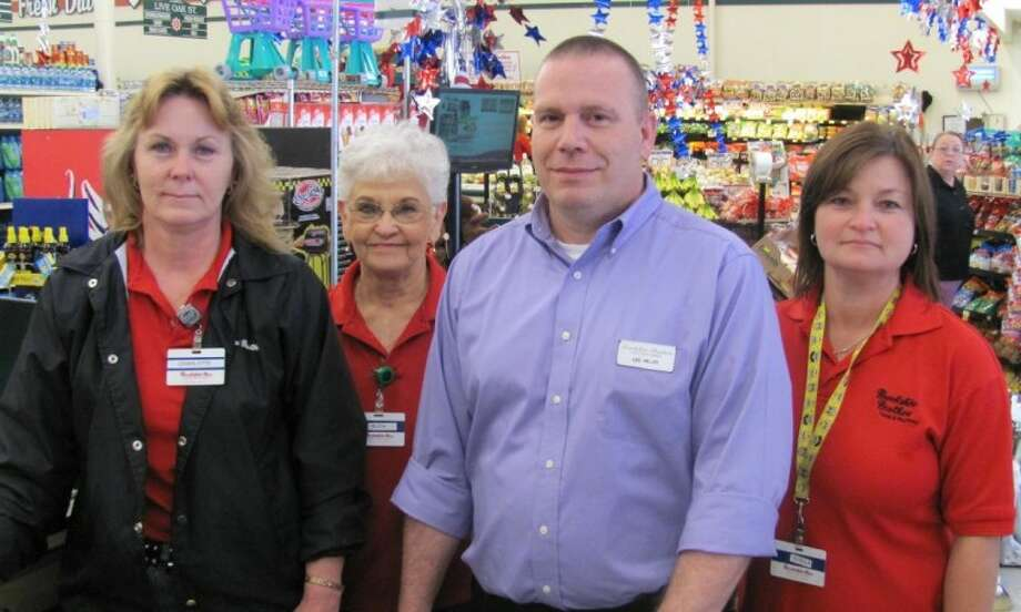 The Brookshire Brothers' annual donation drive for the Coldspring Area Public Library raised 1,109. Shown from left to right: Charlotte Cruz, Ruth Cardenas, Manager Les Miller, and Sheila Mosley. Photo: Submitted Photo